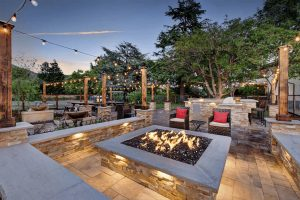 Casa Bella firepit with flames at night