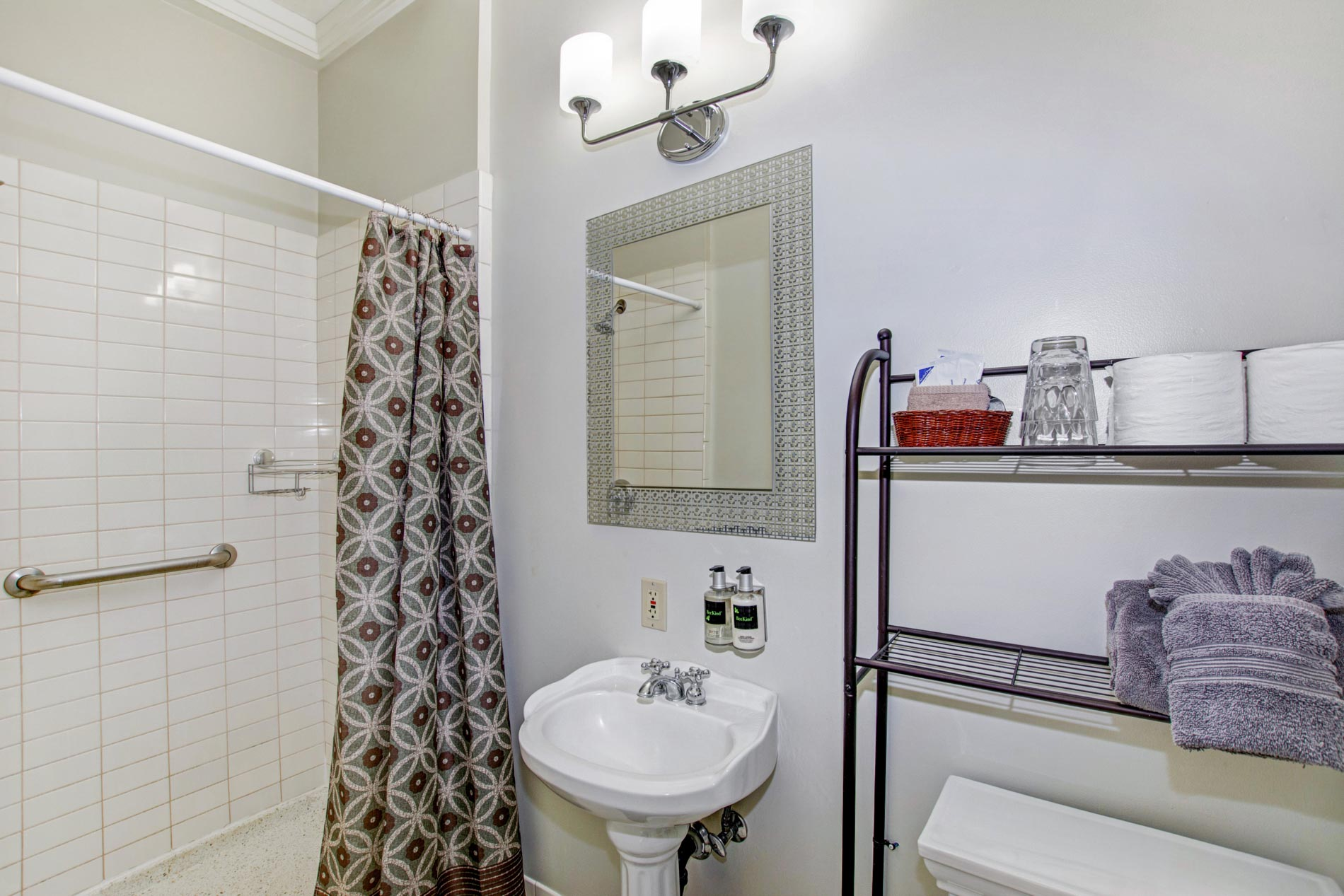 Casa Bella bathroom and shower with pedestal sink