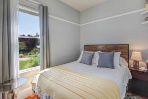 Casa Bella bedroom with queen bed and view of yard