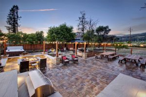 Twilight shot of Casa Bella barbecue, fire pit and outdoor living areas