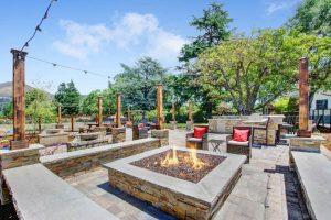Casa Bella fire pit and stone patio seating area