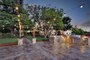 Lights strung above Casa Bella stone patio