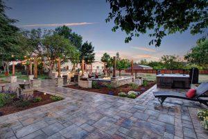 Casa Bella hot tub and stone patio at dusk
