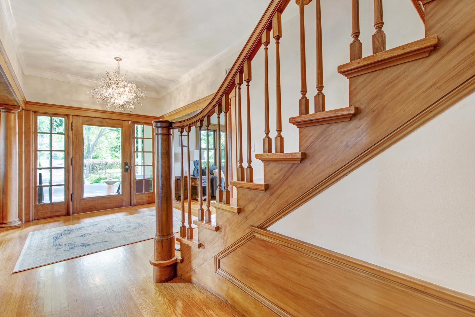 Foyer and side view of stairs at historic Casa Bella estate in Kenwood